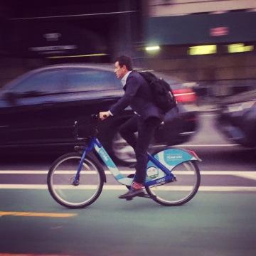 A commuter rides a Citi Bike on Prospect Park West.